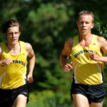 First-year Tucker Wallin and Junior Jeremy Gilbertson maintain their pace during a race earlier this season. Both cross country teams finished in fourth this weekend at the MIAC Championships.