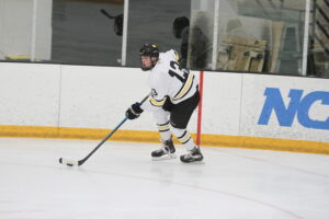 Senior Tyler Rock starts the attack by bringing the puck up the ice.