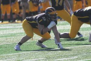 Senior John Krohn prepares to rush the quarterback during a game earlier this season.