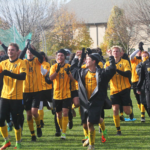 Members of the Men's Soccer team celebrate their win against Macalester which secured them a share of the 2019 MIAC Regular Season Title. The Gusties went 8-1 in conference this season.