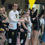 Members of the Gustavus Men's and Women's Swimming and Diving teams cheer on their teammates during a meet earlier this season. Both teams took home first at the Grace Goblirsch Invite.