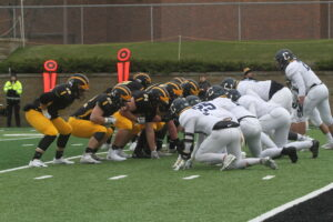 The Gustie offensive line sets up just short of the endzone.