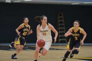 Junior Gabby Bowlin looks to attack the basket quickly after a turnover.