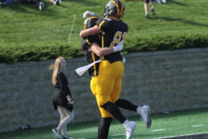Senior Josh Kirk celebrates with a teammate after scoring a touchdown.