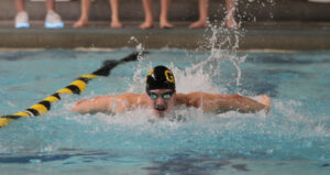 Junior Nolan Larson competes in a butterfly event during a meet earlier this season.