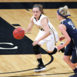 Junior Ava Gonsorowski dribbles the ball up the court for the Gusties. The team won its first two games of the season, defeating Luther and Bethany Lutheran.