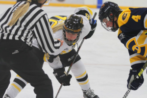 First-year Hailey Holland prepares for the puck to be dropped during a faceoff.