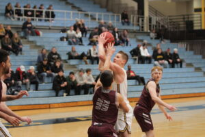 Junior Logan Rezac goes up for a contested shot against an Auggie defender.