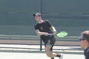 Sophomore Nick Aney competes in a match during the fall season.