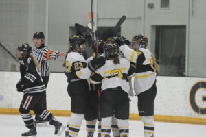 A group of Gusties celebrate after scoring a goal against Hamline.