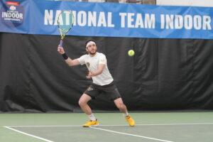 Senior Yassine Derbani returns a serve during the ITA Indoors.