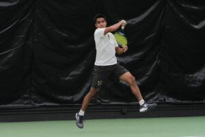 Sophomore Indraneel Raut competes in singles for the Gusties.
