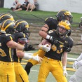 Sophopmore Safety Brady Miller (43) celebrates with his teammates after returning an interception 65 yards. The Gusties came out flat. trailing 0-13 after the first half, but dominated in the second half, scoring 35 unanswered points to improve to 3-0 on the season, and 1-0 in the MIAC.