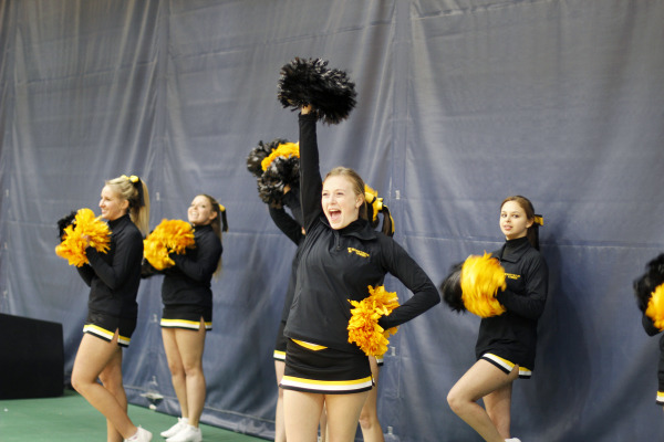 Cheer squad shows off their new members and their enthustiastic routines. Their next performance will be when Men's Basketball takes on Hamline University on Dec. 13.