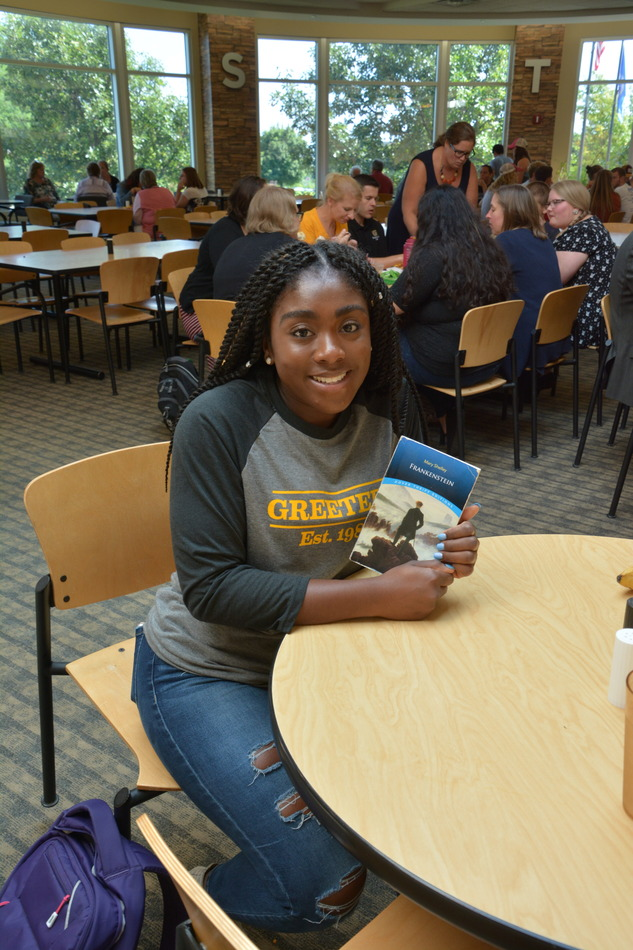 Sophomore Gustie Greeter, Adonya Gray displays a copy of the Reading in Common book,