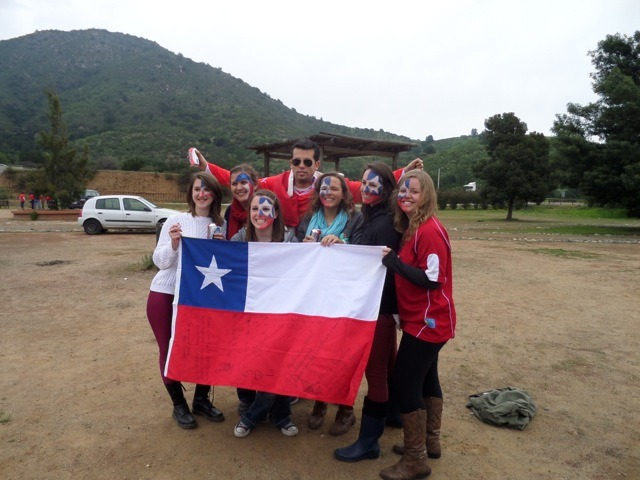 "Hannah and other International students got ready for the game at a Chilean ""asado"" or BBQ. Submitted"