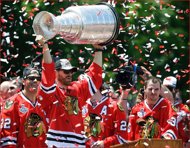 Last year's Stanley Cup Playoff winners, the Blackhawks, hoisted the Stanley Cup high at a parade after their win last season. The Blackhawks are back in the Playoffs this year, along with the Minnesota Wild. Creative Commons