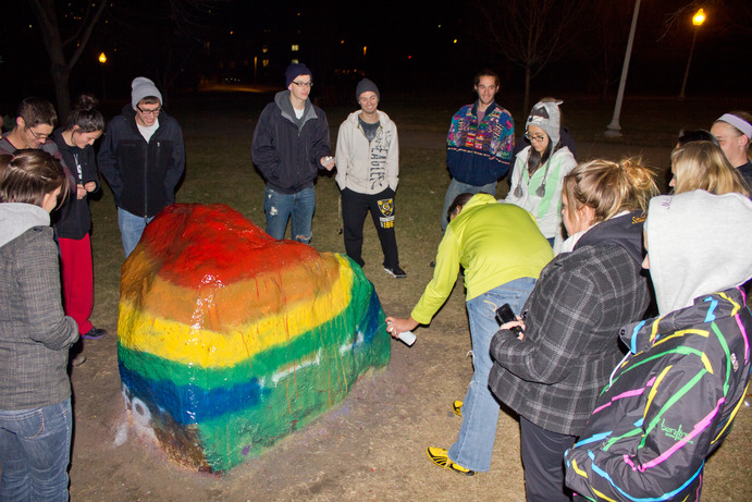 Q&amp;A members paint the rock Sunday night to commemorate the beginning of Coming Out Week. <em>Jessica Buckley</em>