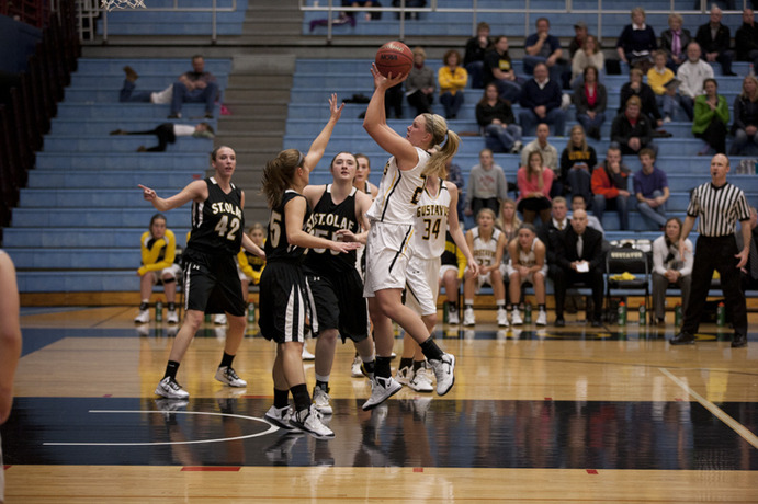 "The Gustavus women's basketball team has a new coach and a new perspective about how to play the game. ""It's a learning curve everyday for all of us,"" Head Coach Kelly said. <em>Gustavus Sports Information</em>"