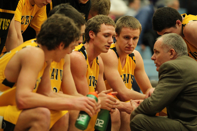 Gustavus Sports Information Coach Mark Hanson talks with his team during a recent game against the University of St. Thomas. Despite having a tough start to the season, the men have stepped up their game and improved their standing in the MIAC.  <em>Gustavus Sports Information</em>