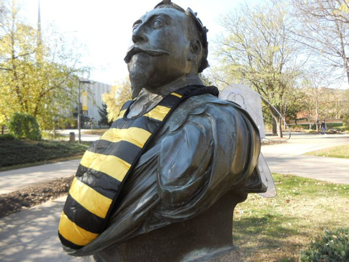 Gus the Bust becomes a bumblebee costume for a day. Office of Marketing and Communications
