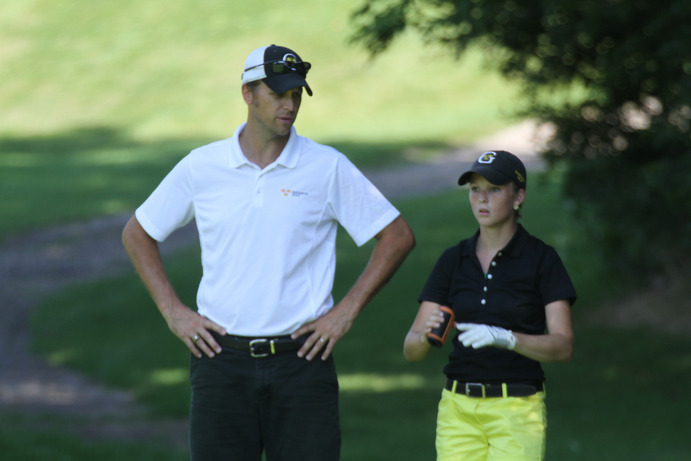 Golf Coach Scott Moe gives Junior Lauren Johnson advice while on the course. Both the men's and women's golf teams are looking to win the conference title this fall and earn a spot in the national tournament. Gustavus Sports Information