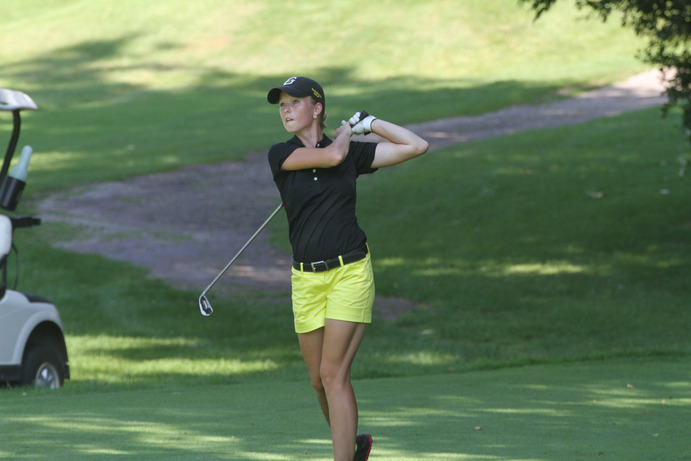 Junior Lauren Johnson followed through a  shot at a tournament this fall. The women are excited about the opportunity the nice weather gives them to get back on the green. Gustavus Sports Information