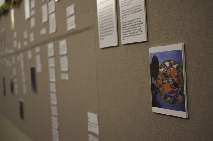 Campus Center bulletin board displays pictures and information that previews the 2014 MAYDAY! Conference. Allison Hosman
