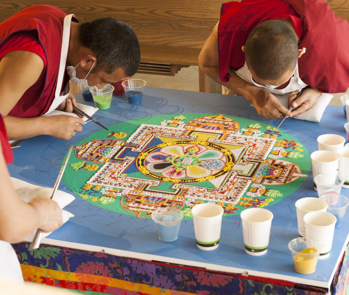 "Tibetan monks created a traditional sand mandala in Christ Chapel as part of the conference. The basic form of the mandala is a square within a circle, which contains four ""gates"" opening to each of the four directions. These gates are the entrance to the teachings contained within the mandala. Agustin Murillo"