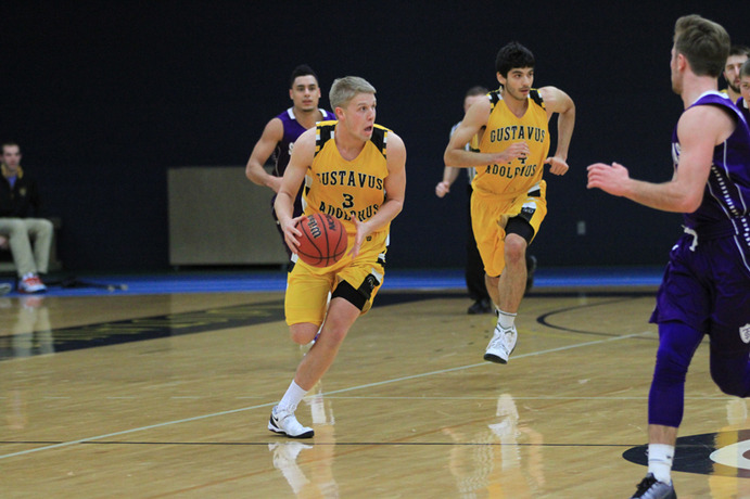 Junior Guard Chad Poppen scored six points in Wednesday's victoy over the Tommies. Men's Basketball are now 4-1 overall and 1-0 in the MIAC. In the MIAC opener on the Gus Young Court on Wednesday, Dec. 5, the team defeated St. Thomas in a nail-biting 68-65 victory. Junior Guard Gary Cooper tallied fifteen points to become the Gustavus top scorer and  Senior Guard Isaac Tapp finished the game with a perfect free throw record, netting four out of four throws.The team has a busy schedule coming up, with three games within the next week. The next one will be against University of Northwestern on Saturday, Dec. 6.