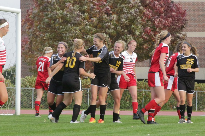 From left: Junior Hannah Sturtz, Sophomore Katie Johnson, Junior Emily Odermatt and Sophomore Chaselyn Miller celebrate Johnson's first collegiate goal in the Gusties' win over St. Benedict's. The Gusties are now sitting at 6-4-2 overall and 3-4 in the MIAC.