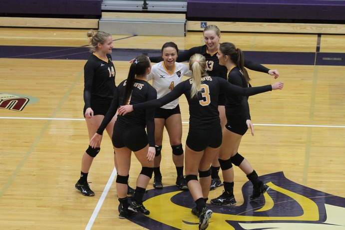 The Gusties celebrate a first-set point against Cal Lutheran on Friday, Nov. 11. The Gusties battled through adversity, but lost in three sets to the defending national champion Reglas in the second round of regional playoffs.