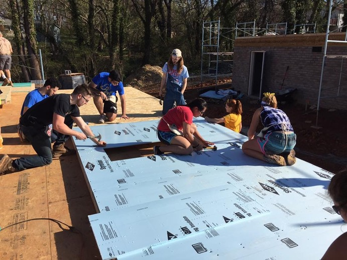 Gustavus students embarked on the annual Habitat for Humanity Spring Break trip to build houses. This group worked in Winston-Salem, North Carolina.