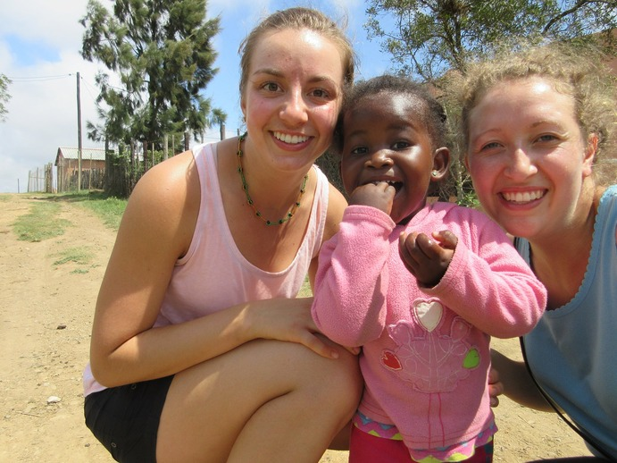 Fellow Gustie Rachel Hain has fun with Laura greeting some of the younger locals at Tshabo.