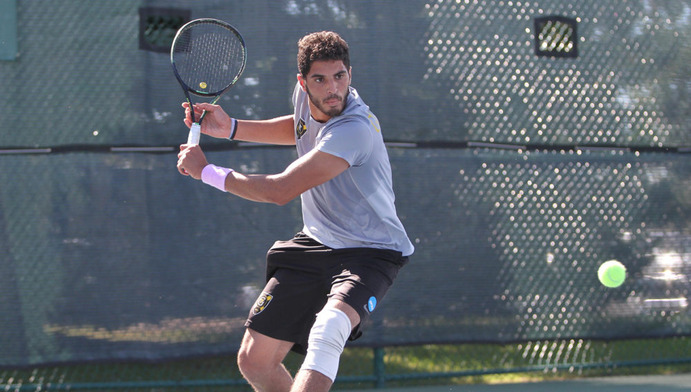 Senior Mohanad Alhouni returns a ball during a match. The team's season record was 22-8 and they hold the No. 1 seed going into MIAC playoffs. They are currently ranked No. 21 in the nation.
