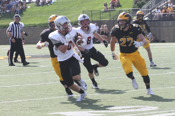 Junior Matt Berkner chases down a Hamline player during the team's homecoming game Sept. 23. The team currently holds an overall record of 3-2 and a record of 2-1 in MIAC play.