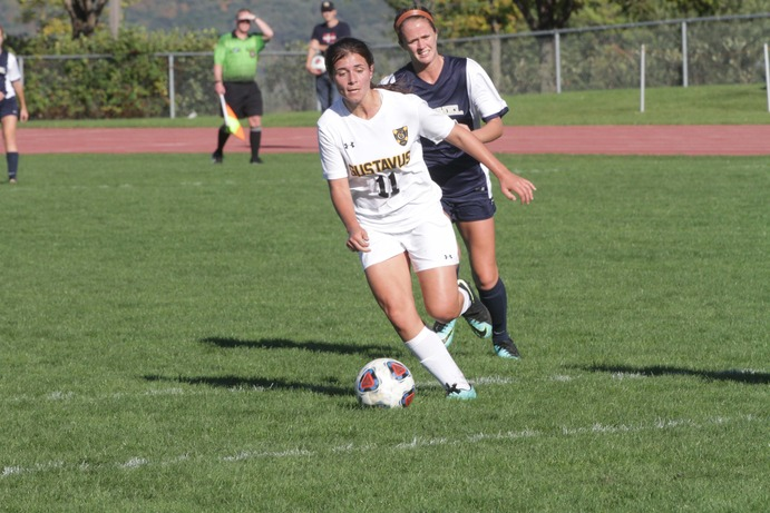 Senior Josie Mazzone skillfully dribbles past a Bethel defender on Oct. 7. The Gusties battled hard but lost 1-0 on a 70th minute goal. The Gusties hold a conference record of 3-3-1 and currently sit at sixth place in the MIAC.