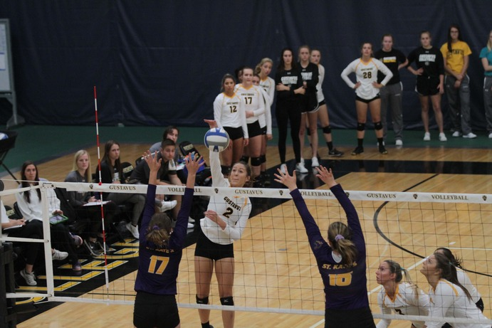 First-year Kate Holtan attacks against St. Kate's as her teammates look on. The No. 11 Gusties defeated St. Kate's and currently hold a record of 20-3 overall, and a conference record of 6-1.