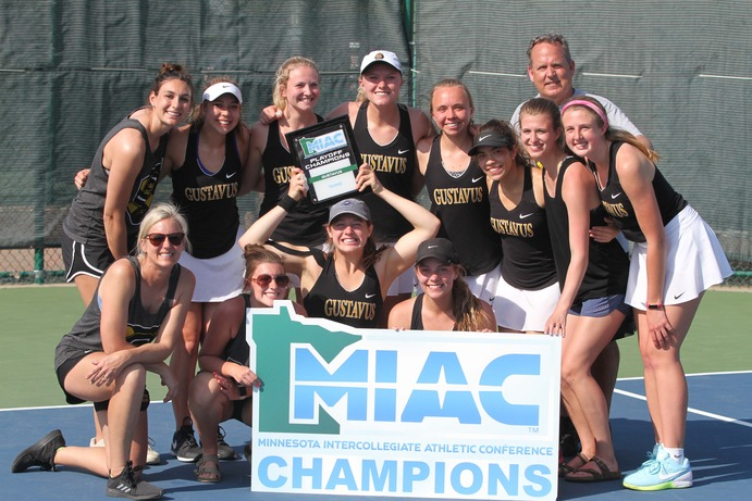 The Gustavus Women's Tennis team boasts their Playoff Champions title following their match against Carleton. The team plays St. Scholastica for their first round match of the NCAA tournament.