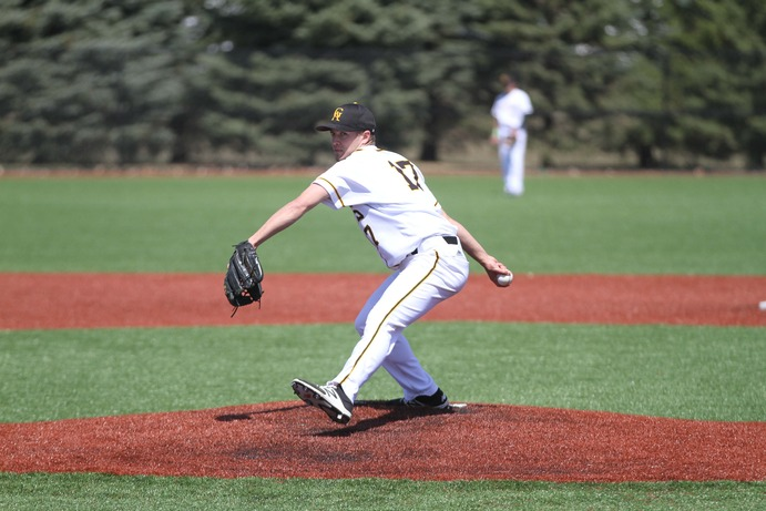 First-year Gavyn Walsh pitches for the Gusties in a game earlier this season against Macalester. After a hard-fought battle with the Tommies, the team lost to a walkoff homerun, ending their season.