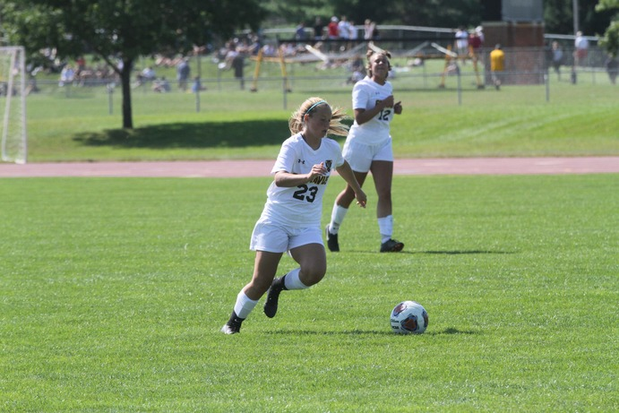 First-year Kenna West dribbles the ball up the field in a game against Nebraska Wesleyan. The Gusties currently hold an overall record of 4-4-1 and a record of 1-2-1 in the MIAC.