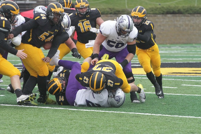 Junior Jake Boykin and Senior Matt Berkner make a tackle for the Gusties during their game against the University of St. Thomas Nov. 3.