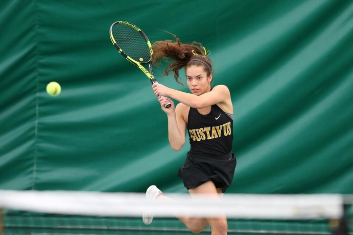 Senior Bri Hartmann competes for the black and gold. The Gusties finished second in conference and will have a bye to the semifinal round of playoffs.