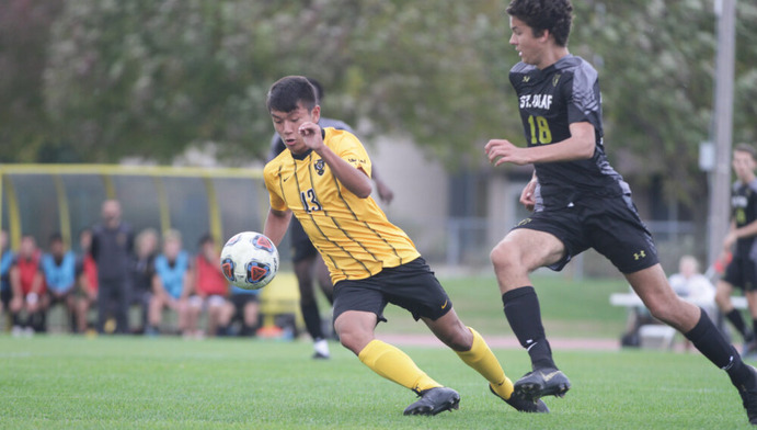First-year Palden Choesang fights for possession of the ball against a St. Olaf defender. The team currently holds a record of 11-2.