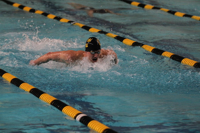 Junior Nolan Larson executes a butterfly stroke during a meet earlier this season. Larson was named MIAC Male Swimmer of the Year and posted a MIAC and school record in the 1:49.12.